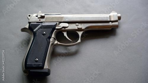 Fotografija Personal gun pistol revolver at home for private security