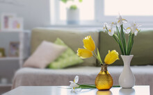 White Home Interior With Spring Flowers And Decorations