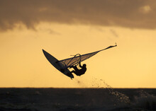 Cool Shot Of  The Silhouette Of A Windsurfer In The Air At Golden Hour