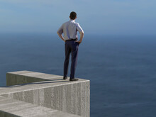 Man Standing On Top Of The Wall