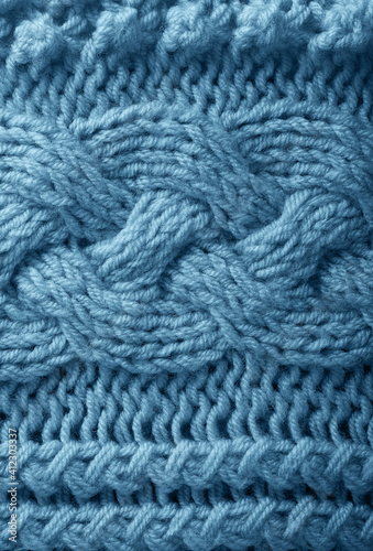 Blue knitted handmade warm textured background close-up