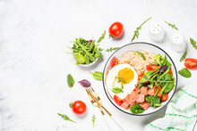 Savory Breakfast. Oatmeal Porrige With Salted Salmon, Egg And Fresh Salad. Healthy Food, Balanced Nutrition. Top View On White Table.