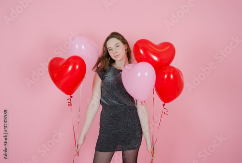 Obraz girl with balloons on a pink background. concept of mothers day, valentines day, womens day, birthday - fototapety do salonu