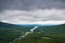 Storm Clouds Over A River Valley