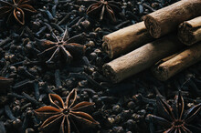Christmas Spices, Cinnamon Sticks And Star Anise On A Bed Of Cloves