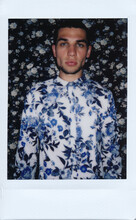 Instant Mini Film Photo Of Male Model In Floral Pattern Shirt