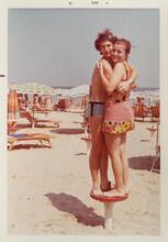 70's Couple Hug At The Beach