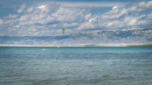 View From Zdrijac Beach Between Nin Bay And Adriatic Sea On Kite Surfers Or Kitesurfing With Mountain Range Of Dinaric Alps In Background, Croatia