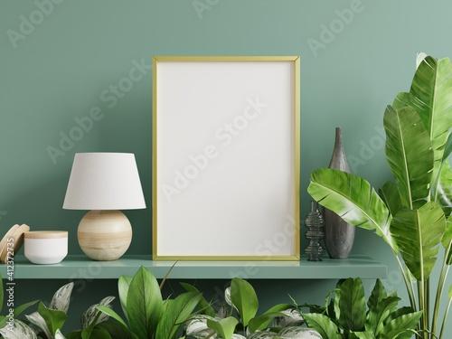 Fototapeta Mockup photo frame on the green shelf with beautiful plants. obraz