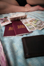 Passports And Money Laid Out On Bed