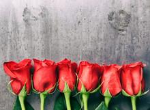 Valentine: Half Dozen Red Roses On Grunge Metal Background
