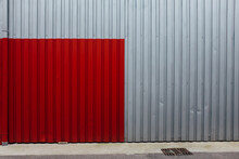 Red Square Painted On Corrugated Metal Wall
