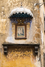 Painting Of Madonna And Child Hanging On A Facade