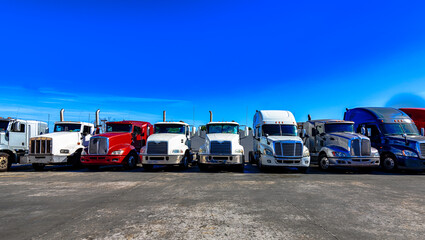 HDR image of Semi trucks lined up on a parking lot.