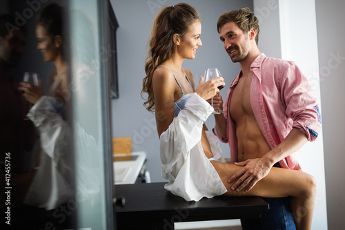Obraz Attractive couple sharing intimate moments in bedroom - fototapety do salonu
