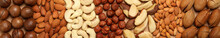 Set Of Different Nuts On Whole Background, Top View
