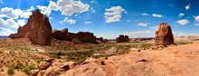 Panoramic Shot Of Rock Formations On Landscape Against Sky