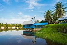 A Church And Traditonal House In The Bank Of Beautiful Tahai Lake, A Famous Natural Tourist Destination In Palangkaraya, Central Kalimantan, Indonesia