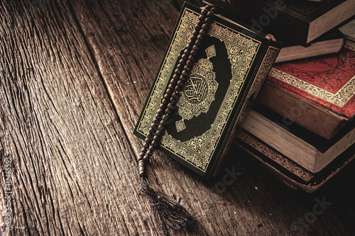 Tablou Canvas Koran - holy book of Muslims ( public item of all muslims ) on the table , still life