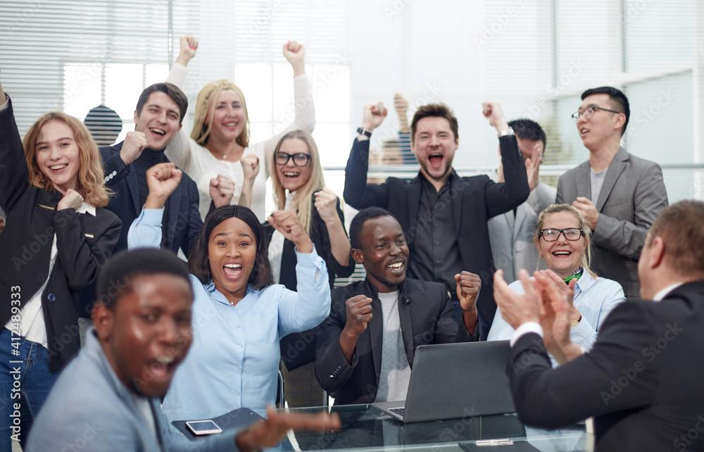 Fototapeta big happy business team showing their success.