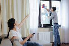 The Wife Exploits Her Husband. She Watches TV And Orders To Wash The Window