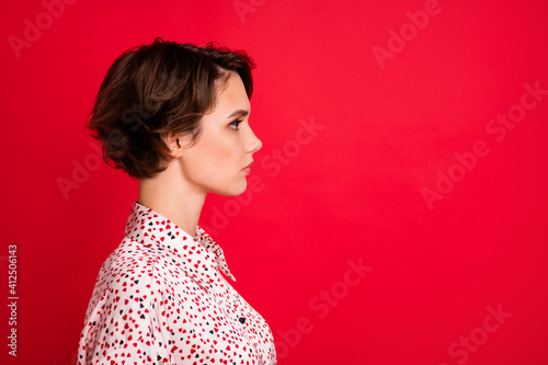 Fototapeta Profile side view portrait of lovely serious content brown-haired girl copy space ad isolated over bright red color background obraz