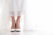 Young Bride Wearing Beautiful Wedding Shoes Indoors, Closeup. Space For Text