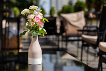 Decorative Vase With Fresh Roses On The Table