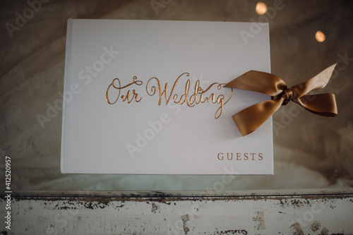 Fotografie, Tablou Top view of a guest book for a wedding ceremony on a vintage-style wooden table