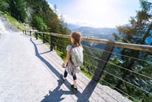 Children Hiking On Beautiful Summer Day In Alps Mountains Austria, Resting On Rock And Admire Amazing View To Mountain Peaks. Active Family Vacation Leisure With Kids. Outdoor Fun And Healthy Activity