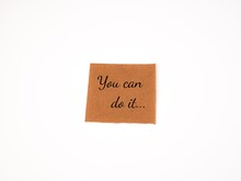 """An Image Of A Piece Of Paper Written """"you  Can Do It"""" Isolate On A White Background."""