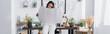 Leinwandbild Motiv african american interior designer holding project while standing at work desk, banner