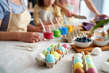 Close Up Of Dyeing Easter Eggs In The Family Circle