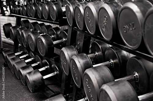 barrels in a cellar close up of a dumbbell weights © Iliya Mitskavets