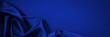 Leinwandbild Motiv Dark blue silk satin background. Copy space for text or product. Wavy soft folds on shiny fabric. Luxurious deep blue background. Valentine, Christmas, Anniversary, Black Friday. Web banner.