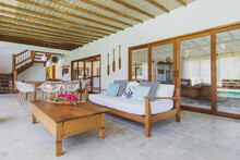 Modern Summer Holiday Or Vacation Wooden Beach House Interior With Rustic Luxury Sofas, Tables And Decoration.
