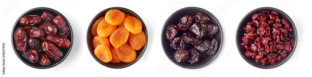 Fototapeta Various dried fruits in bowl isolated on white, from above