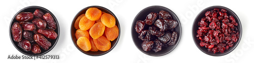 Fotografia, Obraz Various dried fruits in bowl isolated on white, from above