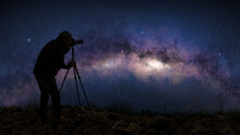Silhouette Of A Photographer Shooting The Milky Way In A Starry Night Sky.