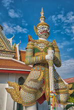 Thai Temple With Giant Protector At Entrance