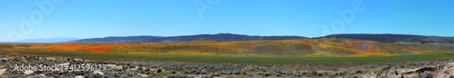 Fotografiet Scenic View Of Mountains Against Clear Blue Sky