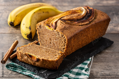 Homemade banana bread on rustic wooden table