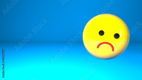 Fotografie, Obraz Sad emoticon on a blue background, with a place for your text