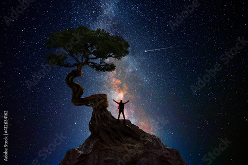 Man under a tree in front of the universe © quickshooting