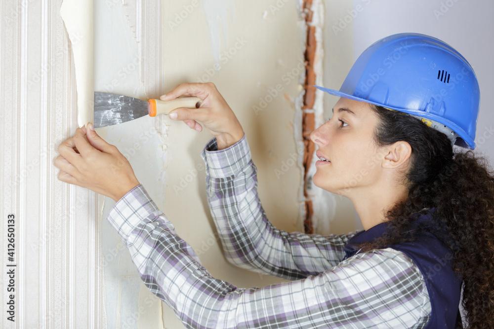 Fototapeta woman removing wall paper