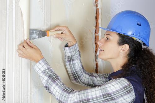 Fototapeta woman removing wall paper obraz