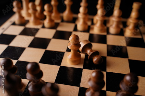 Close up of black chess pieces on board Fotobehang