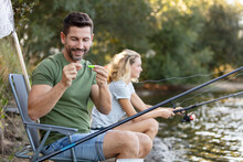 Man And Woman Fishing Together In River
