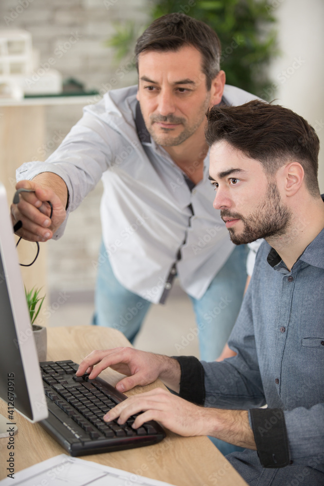 Fototapeta teacher and student working on computer