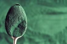 Ground Spirulina Algae On A Metal Spoon With Copy Space